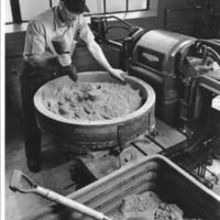 Frank Gannon creating a mold for sand casting